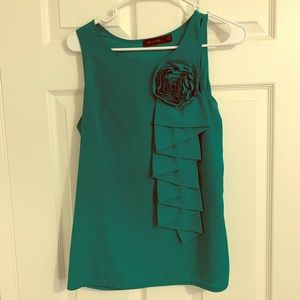 Limited sleeveless blouse in teal